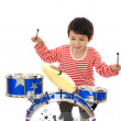 Asian young boy playing blue drum on white background — Stock Photo