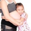 Beautiful pregnant woman and her daughter — Stock Photo #28098349