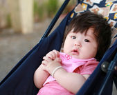 Newborn baby girl on perambulator — Stock Photo