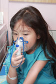 Little girl with a mask for inhaler in hospital — Stock Photo