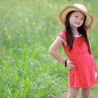 Stock Photo: Portrait of beautiful happy little girl in a field of yellow flo
