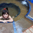 Adorable girl in hot spring water pool — Stock Photo