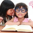 Cute little asian girl whispering something to her sister — Stock Photo
