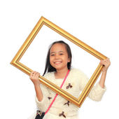 Happy little girl holding a picture frame on white background — Stock Photo