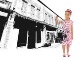 Adorable girl drawing commercial building — Stock Photo