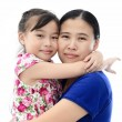 Close Up Of Affectionate Mother And Daughter on white isolated background — Stock Photo #28111281
