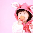 Baby dressed in Easter bunny ears with carrot — Stock Photo