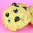 Stock Photo: Cookie chocolate chip on pink background