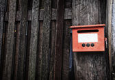 Mail Box on the old wooden wall — Stock Photo