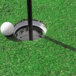 Stock Photo: Golf ball go to hole