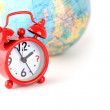 Red alarm clock and globe world time — Stock Photo
