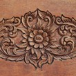 Pattern of flower carved on wood background — Stock Photo