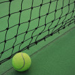 Stock Photo: Tennis ball on court and net