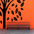 Vintage Bench Against blank Wall with tree — Stock Photo