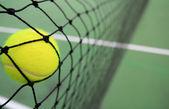 Tennis ball in net — Stock Photo