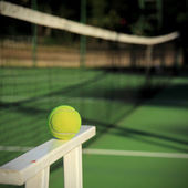 Tennis ball with net background — Stock Photo