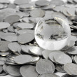 Globe staying on coins. money concept — Stock Photo