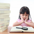 Beautiful little and serious asian girl reading book — Stock Photo