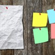 Blank paper crumpled and post it note on wood panel  — Stock Photo