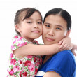 Close Up Of Affectionate Mother And Daughter on white isolated b — Stock Photo #28145945
