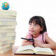 Student little girl reading with magnifying glass look the globe — Stock Photo
