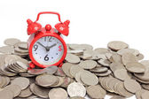 Alarm red clock with coins on white background, time is money co — Stock Photo