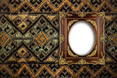 Gold ornate frame on tradition thai background — Stock Photo