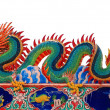 Chinese style dragon statue on the roof white isolated backgroun — Stock Photo