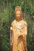 Kuan Yin with bamboo background — Stock Photo