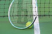 Tennis ball on tennis court — Stock Photo