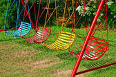 Colorful swing hanging in garden — Stock Photo