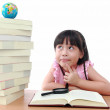 Stock Photo: Student little girl reading with magnifying glass look the globe
