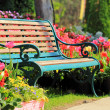 Vintage Bench in tulips garden — Stock Photo