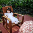 Asian little girl on the chair — Stock Photo