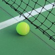 Stock Photo: Tennis ball in net