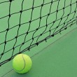 Tennis ball in net — Stock Photo