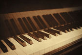 Closeup of piano keys and wood grain with sepia — Stock Photo