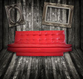 Sofa furniture in wooden room with photo frame — Stock Photo