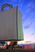 Shopping bag hot air balloon at sunrise — Stock Photo