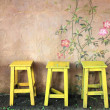 Stock Photo: Old vintage wooden chair and wall