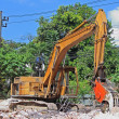 Stock Photo: Heavy excavator Destroyed the building