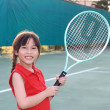 Stock Photo: Portrait of sporty beautiful asigirl tennis player