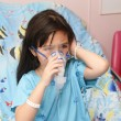 Child wearing a patient gown has an oxygen mask — Stock Photo #28768323