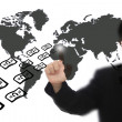 Businessman pressing world map touchscreen with money fly — Stock Photo