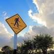 Crosswalk road sign under a beautiful sky background  — Stock Photo