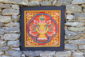 Wood carving and rock wall bhutan culture — Stock Photo
