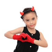 Beautiful little asian girl with heart sign — Stock Photo