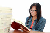 Senior asian woman reading book on white background — Stock Photo
