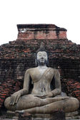 Buddha on ruins temple sitting — Stock Photo