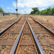 Railway crossroad under blue sky — Stock Photo #28770641